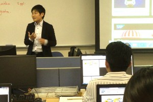 Representative at IUJ's E-Lab explaining the key components of the course.